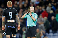 Referee Jon Moss shares chats to Celta Vigo's John Guidetti at full time during the Pre-Season Friendly match between Burnley and Celta Vigo at Turf Moor, Burnley, England on 1 August 2017. Photo by Paul Thompson.