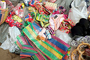 Products for sale at the small monthly market at the remote and roadless Khmu village of Ban Seua-Thiek, Phongsaly province, Lao PDR. The market traders travel along the Nam Ou visiting different villages selling every kind of Chinese and Vietnamese product that one might need - like biscuits and flip flops, washing powder and salt. Ban Seua-Thiek will soon be temporarily relocating away from the Nam Ou river due to the construction of the Nam Ou Cascade Hydropower Project Dam 5.