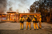 HEALDSBURG, CA - OCTOBER 27: Firefighters survey a burning home along Highway 128 during the Kincade Fire in Healdsburg, California, U.S. on Sunday October 27, 2019. Photographer: Philip Pacheco/Bloomberg