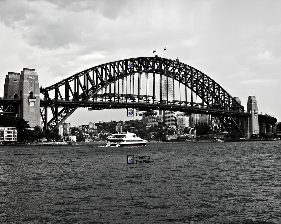 The Sydney Harbour bridge, an image that is known around the world as a symbol and icon of Australia. It is also a great historic monument and that is why I have chosen to produce this image in black and white to remind us of that history. <br /> <br /> Construction started in 1923 and the bridge was opened on the 19th March 1932, the New South Wales Premier Jack Lang was expected to cut the ribbon and open the bridge. However, a man called Francis de Groot in military uniform rode his horse onto the bridge and cut the ribbon declaring the bridge open in the name of the people of Australia. <br /> <br /> This is one of those great stories in history and whether your on the side of the premier or the loan horseman it shows the spirit of the people of Australia and the diversity of its history. <br /> <br /> This image is ready to download for personal or commercial use and to order as a limited edition print. I will only make available 50 prints of this image, you can choose to have it printed on canvas or as a framed or unframed print ensuring you have an exclusive peace of highly collectable photo art to add to any home or business.