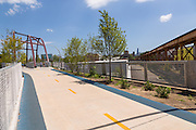 The Milwaukee Avenue bridge along the 606 elevated bike trail, green space and park built on the old Bloomingdale Line in the Wicker Park neighborhood in Chicago, Illinois, USA