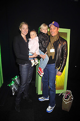 SEB & HEIDI BISHOP with their children SKY and MAX at the premier of Ben Ten Alien Force at the Old Billingsgate Market, City of London on 15th February 2009.