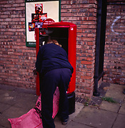 A294NF Postman emptying post box