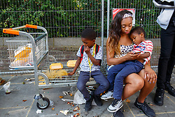 © Licensed to London News Pictures. 29/08/2016. London, UK. A family enjoys the second day of Notting Hill Carnival in west London, Monday 29 August 2016. Photo credit: Tolga Akmen/LNP