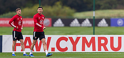 CARDIFF, WALES - Monday, October 5, 2020: Wales' Chris Mepham (L) and Kieffer Moore (R) during a training session at the Vale Resort ahead of the International Friendly match against England. (Pic by David Rawcliffe/Propaganda)