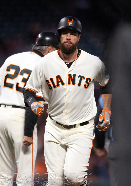 San Francisco Giants' Brandon Belt runs out a solo home run against the San Diego Padres during the fourth inning of a baseball game, Thursday, Aug. 29, 2019, in San Francisco. Third base coach Ron Wotus (23) is at left. (AP Photo/D. Ross Cameron)