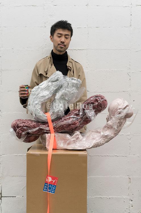 artist Sou Suzuki with his sculpture at RoomF solo exhibition in Tokyo 2018 December