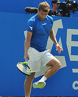 Tennis - 2017 Aegon Championships [Queen's Club Championship] - Day One, Monday<br /> <br /> Men's Singles, Round of 32<br /> Grogor Dimitrov [Bulgaria] vs. Ryan Harrison [USA]<br /> <br /> Ryan Harrison bangs his shoe after slipping on the grass on Centre Court.<br /> <br /> COLORSPORT/ANDREW COWIE