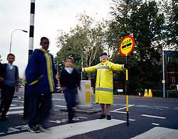 School crossing patrol outside school, UK