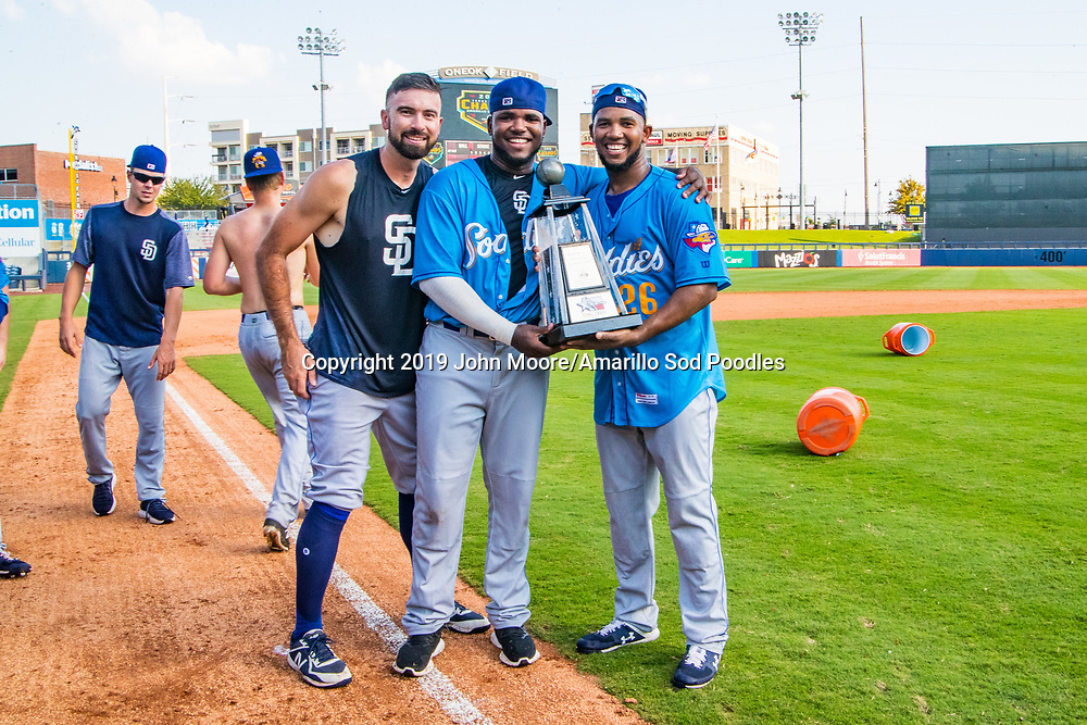 Amarillo Sod Poodles pitcher Jesse Scholtens (38), Amarillo Sod Poodles pitcher Carlos Belen (50) and Amarillo Sod Poodles pitcher Emmanuel Ramirez (26) poses with the trophy after the Sod Poodles won against the Tulsa Drillers during the Texas League Championship on Sunday, Sept. 15, 2019, at OneOK Field in Tulsa, Oklahoma. [Photo by John Moore/Amarillo Sod Poodles]
