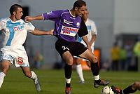 Fotball<br /> Frankrike 2004/05<br /> Istres v Olympique Marseille<br /> 2. oktober 2004<br /> Foto: Digitalsport<br /> NORWAY ONLY<br /> FRANCK CHAUSSIDIERE (IST) / LAURENT BATLLES (OM)