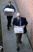 CHARLOTTESVILLE, VA - FEBRUARY 15: Members of the Charlottesville police department carry containers with evidence to the Charlottesville Circuit courthouse for the George Huguely trial. Huguely was charged in the May 2010 death of his girlfriend Yeardley Love. She was a member of the Virginia women's lacrosse team. Huguely pleaded not guilty to first-degree murder. (Credit Image: © Andrew Shurtleff