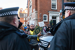 """Mayfair, London, November 28th 2014. A protest against Egypt's leader Al-Sisi descended into moinor scuffles as right wing """"patriots"""" from anti-Islamic group Britain First arrived to protest against the presence of Islamist preacher Anjem Choudary, who was recently arrestred as part of an ant-terror operation. Playing patriotic British Music, Britain First accused Muslims of worshiping a """"devil"""" and a """"paedophile prophet"""". Police had to intervene before hotheads on both sides became violent. PICTURED: Police block the path of an anti-Sisi protester as he tries to reach the door of the Egyptian embassy."""