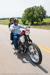 Danell and Stacy McCleary riding north on highway 79 on the Run to the Line for lunch and biker vs Cowboy rodeo games at the Spur Creek Ranch in Newell during the annual Sturgis Black Hills Motorcycle Rally. SD, USA. Wednesday August 9, 2017. Photography ©2017 Michael Lichter.