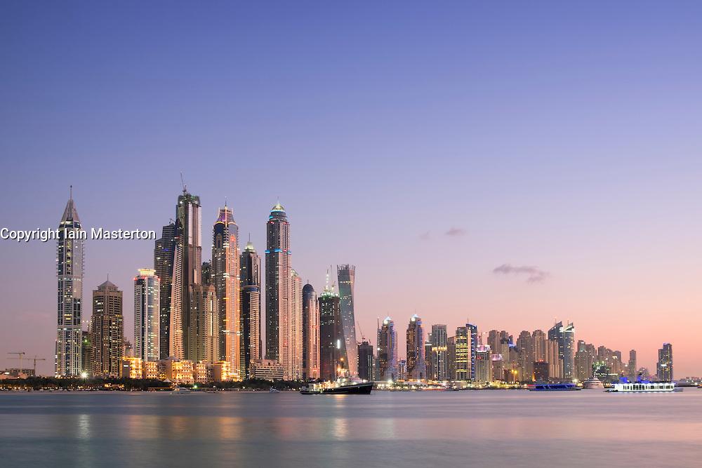 Skyline of skyscrapers at dusk  at Marina district in Dubai United Arab Emirates