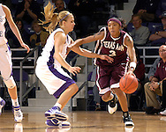 Texas A&M guard Takia Starks (3) drives against pressure from Kansas State's Claire Coggins (L) in the second half at Bramlage Coliseum in Manhattan, Kansas, January 6, 2007.  K-State upset the 17th ranked Aggies 48-45.