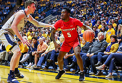 Dec 1, 2018; Morgantown, WV, USA; Youngstown State Penguins guard Kendale Hampton (5) drives baseline on West Virginia Mountaineers forward Logan Routt (31) during the first half at WVU Coliseum. Mandatory Credit: Ben Queen-USA TODAY Sports