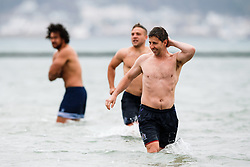 Head of Performance Paul Bunce looks on as Bristol Rugby take part in a morning after game recovery session in the sea - Rogan/JMP - 29/10/2017 - RUGBY UNION - Jersey Marine Lake - St Helier, Jersey - Jersey Reds v Bristol Rugby - Greene King IPA Championship.