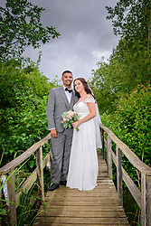 Bride and Groom on Rustic Bridge at Three Lakes, Westmill Farm in Hertfordshire.
