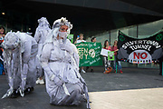 White Rebels from Extinction Rebellion perform in front of environmental activists and local residents protesting against the construction of the Silvertown Tunnel on 5th June 2021 in London, United Kingdom. Campaigners opposed to the controversial new £2bn road link across the River Thames from the Tidal Basin Roundabout in Silvertown to Greenwich Peninsula argue that it is incompatible with the UKs climate change commitments because it will attract more traffic and so also increased congestion and air pollution to the most polluted borough of London.