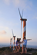 Excited young girls stand near Wind turbines. Photographed in Israel, Golan Heights,  near kibbutz Ein Zivan,