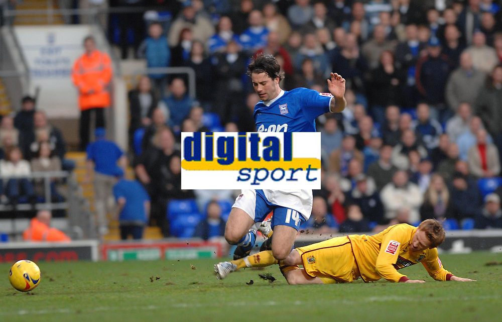 Photo: Ashley Pickering.<br />Ipswich Town v Burnley. Coca Cola Championship. 02/12/2006.<br />Ipswich's Alan Lee (blue) is tackled