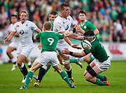 England second-row Stan South off-loads as he is tackled by Ireland scrum-half Stephen Kerins and  second-row Sean O'Connor during the World Rugby U20 Championship Final   match England U20 -V- Ireland U20 at The AJ Bell Stadium, Salford, Greater Manchester, England onSaturday, June 25, 2016. (Steve Flynn/Image of Sport)