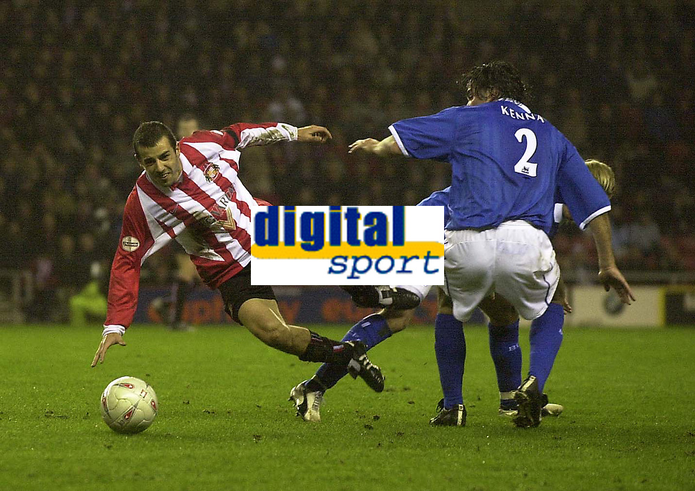 Photo. Glyn Thomas.<br /> Sunderland v Birmingham. FA Cup fifth round.<br /> Stadium of Light, Sunderland. 14/02/2004.<br /> Sunderland's Julio Arca (L) is brought down by Jeff Kenna and Robbie Savage.