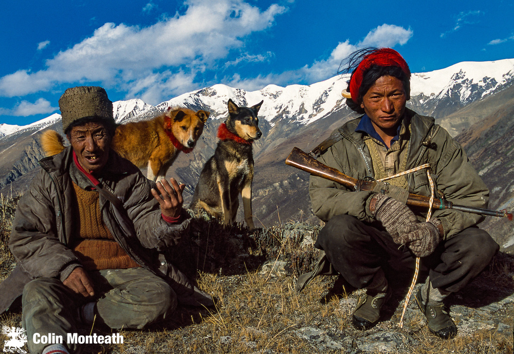 Hunters near Ata Kang La, with dogs and antique gun, looking for Bharal, Blue sheep. Ata Kang La is an ancient trading route that leads into Burma. Plant hunter Frank Ingdon ward crossed it in 1930s on his way to live in Pemako region for 9 months
