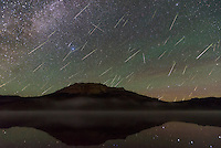 In mid-August I photographed the annual Perseid meteor shower. But this was no ordinary year, as there were twice as many meteors as normal. Beartooth Lake, at almost 9,000 feet in the Beartooth Mountains was the perfect place to watch from. I was worried about the weather, with thick clouds at sunset and a wildfire only 7 miles away. But it ended up being a beautiful night. The show got started at 1AM when the moon set, leaving the sky completely dark. While listening to every little sound around me (this is grizzly bear country) I counted 250 meteors in 4 hours. With my camera pointed northwest at Beartooth Butte, I captured 93 of them. I combined them all into this composite image. The radiant (Perseus) was to the upper right outside of the frame. As dawn approached, fog swirled around the glassy surface of the lake. Hand warmers strapped to my lens prevented the glass from fogging up. I don't know how cold it was, but I do know my water bottle froze and I was snowed on at the pass earlier in the evening.