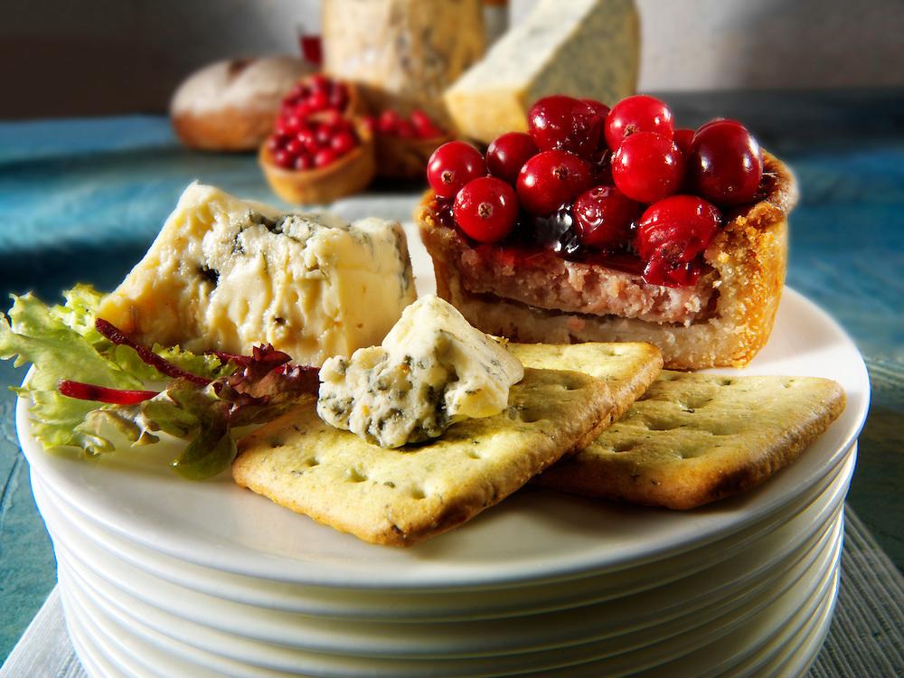Traditional blue Stilton cheese  with cranberry pork pie stock photos