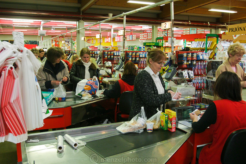 Customers at the check out stand of a supermarket in the city of Reykjavik, Iceland.