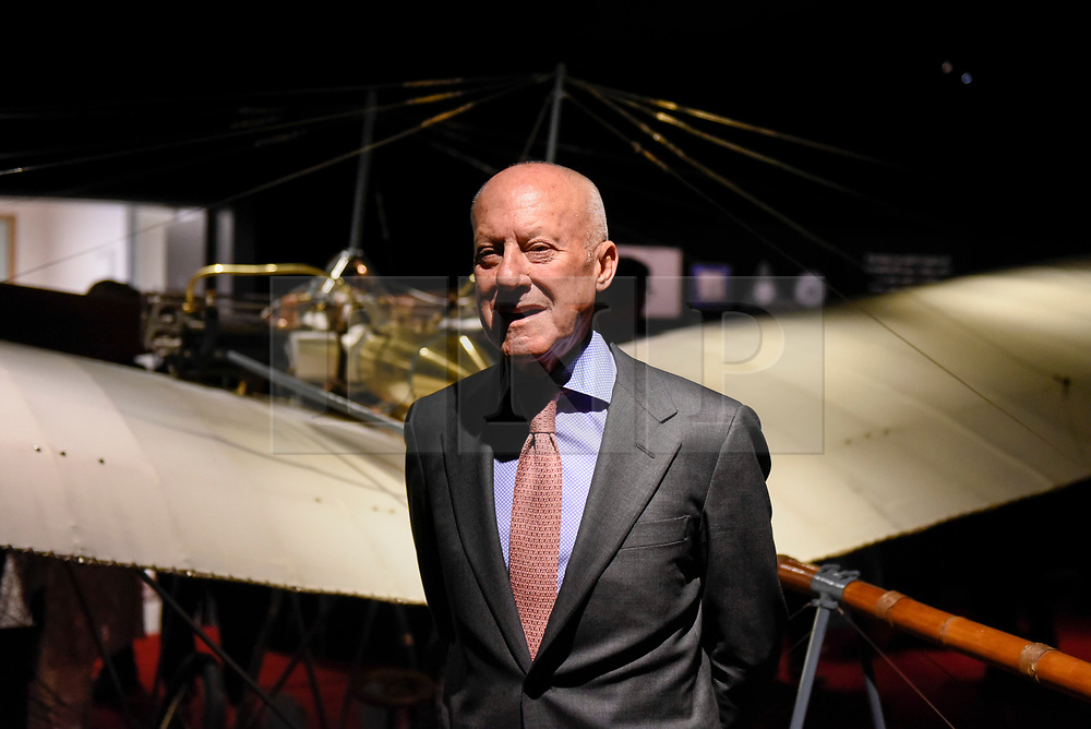 """© Licensed to London News Pictures. 23/05/2017. London, UK.   Norman Foster stands in front of a replica Santos-Dumont 20 aeroplane at the press preview of """"Cartier in Motion"""", an exhibition on Cartier, co-curated by celebrated architect Lord Norman Foster and Design Museum director Deyan Sudjic, at the Design Museum in London.  The exhibition runs from 25 May to 28 July 2017. Photo credit : Stephen Chung/LNP"""