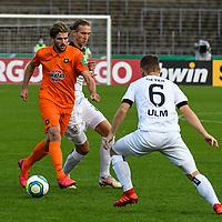 12.09.2020, Donaustadion, Ulm, GER, DFB Pokal, SSV Ulm 1846 Fussball vs FC Erzgebirge Aue, <br /> DFL REGULATIONS PROHIBIT ANY USE OF PHOTOGRAPHS AS IMAGE SEQUENCES AND/OR QUASI-VIDEO, <br /> im Bild Vinko Sapina (Ulm, #22), Philipp Zulechner (Aue, #14), Thomas Geyer (Ulm, #6)<br /> <br /> Foto © nordphoto / Hafner