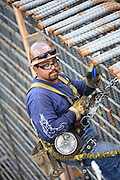 Construction Workers Building With Rebar