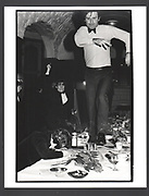 Onanist dining club, Oxford Union, Macmillan Room,a man racing  down a table March 1981, Exhibition in a Box