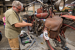 Kevin Naser of NE's 1916 Indian gets needed repairs as Triple S Harley-Davidson opened their shope for the riders and crew after the finishline festivities during the Motorcycle Cannonball Race of the Century. Stage-2 from York, PA to Morgantown, WV. USA. Sunday September 11, 2016. Photography ©2016 Michael Lichter.