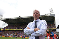 Alan Pardew, the Crystal Palace manager looks on as he arrives at the dugout before k/o. Barclays Premier league match, Crystal Palace v Arsenal at  Selhurst Park in London on Sunday 16th August 2015.<br /> pic by John Patrick Fletcher, Andrew Orchard sports photography.
