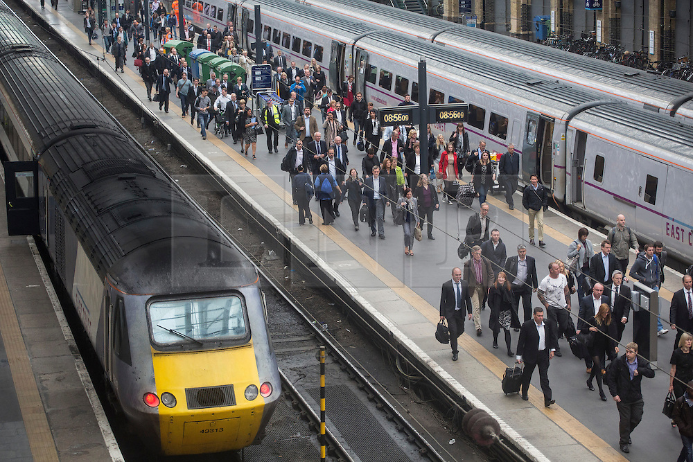 © licensed to London News Pictures. London, UK 26/09/2013. Commuters at King's Cross Station walking to King's Cross Square which officially opens and becomes London's newest public space on Thursday, 26 September, 2013. Photo credit: Tolga Akmen/LNP
