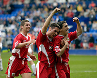 Photo: Jed Wee.<br />Tranmere Rovers v Bristol City. Coca Cola League 1. 22/04/2006.<br /><br />Bristol City's Bradley Orr (C) and Alex Russell (L) celebrate with penalty scorer Craig Woodman.