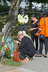 © Licensed to London News Pictures 21/09/2021. <br /> Kidbrooke, UK, A friend looks upset after laying flowers at the scene. A large police cordon is still in place around Cator Park at Kidbrooke Village in Kidbrooke, South East London today after the body of 28 year old school teacher Sabina Nessa was found near a community centre. Police believe Sabina was murdered by a stranger. Photo credit:Grant Falvey/LNP