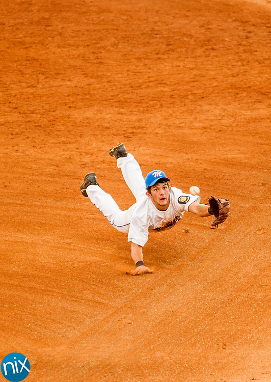 Mooresville Post 66's Seth Hartings dives for the ball but misses against Concord Post 51 Monday night at Lake Norman High School. Concord won the game 6-5.