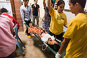 20 MAY 2013 - MAE KASA, TAK, THAILAND:  Health care workers help a woman who had gone into shock because of an etopic pregnancy in the SMRU clinic intensive care room at the Mae Kasa clinic. Health professionals are seeing increasing evidence of malaria resistant to artemisinin coming out of the jungles of Southeast Asia. Artemisinin has been the first choice for battling malaria in Southeast Asia for 20 years. In recent years though,  health care workers in Cambodia and Myanmar (Burma) are seeing signs that the malaria parasite is becoming resistant to artemisinin. Scientists who study malaria are concerned that history could repeat itself because chloroquine, an effective malaria treatment until the 1990s, first lost its effectiveness in Cambodia and Burma before spreading to Africa, which led to a spike in deaths there. Doctors at the Shaklo Malaria Research Unit (SMRU), which studies malaria along the Thai Burma border, are worried that artemisinin resistance is growing at a rapid pace. Dr. Aung Pyae Phyo, a Burmese physician at a SMRU clinic just a few meters from the Burmese border, said that in 2009, 90 percent of patients were cured with artemisinin, but in 2010, it dropped to about 70 percent and is now between 55 and 60 percent. He said the concern is that as it becomes more difficult to clear the parasite from a patient, progress that has been made in combating malaria will be lost and the disease could make a comeback in Southeast Asia.    PHOTO BY JACK KURTZ