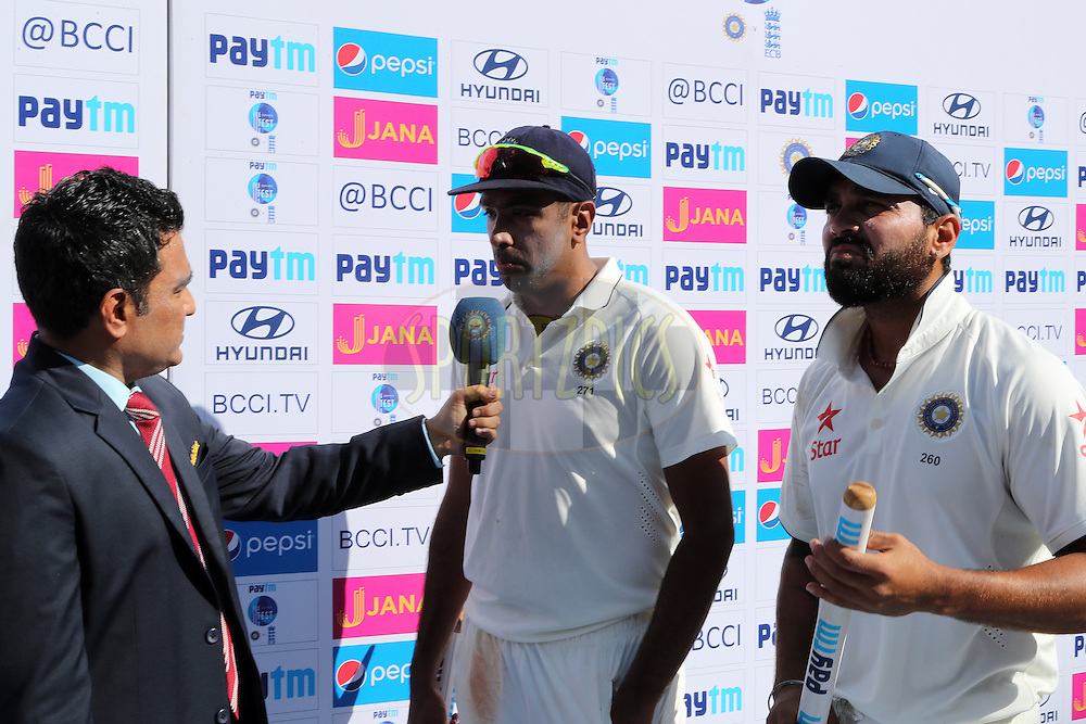 Ravichandran Ashwin of India and Ravindra Jadeja of India are interviewed after the match during day 5 of the fourth test match between India and England held at the Wankhede Stadium, Mumbai on the 12th December 2016.<br /> <br /> Photo by: Ron Gaunt/ BCCI/ SPORTZPICS