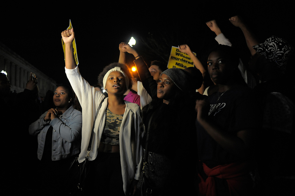 Protesters chant for justice in the case of Michael Brown on November 24, 2014 in Washington, D.C. The protest was in response to a decision by a grand jury to not indict Ferguson police officer Darren Wilson for the shooting of Michael Brown in August earlier this year. November, 24, 2014 in Washington, DC.