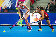 The Netherlands Naomi Van As is shadowed by Julia Pons of Spain. Spain v The Netherlands - Unibet EuroHockey Championships, Lee Valley Hockey & Tennis Centre, London, UK on 23 August 2015. Photo: Simon Parker