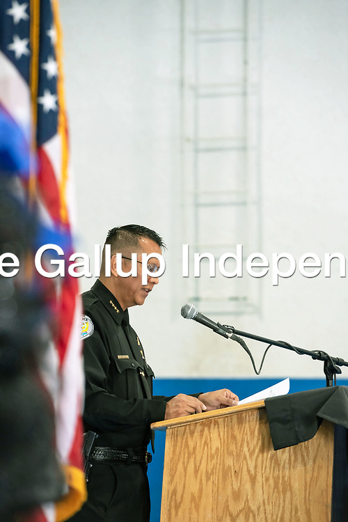 Police Chief Franklin Boyd, at the podium, remembers the fallen officers during the Police Memorial Ceremony. The ceremony was held at the Larry Brian Mitchell Recreation Center in Gallup on Wednesday.