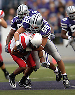 Kansas State defensive end Ian Campbell (98) wraps up Illinois State wide receiver (81) for a loss in the first half at Bill Snyder Family Stadium in Manhattan, Kansas, September 2, 2006.  The Wildcats beat the Redbirds 24-23.