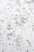 wet snow sticking to a window