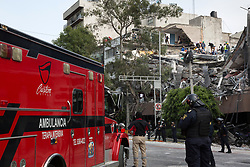 A building that collapsed in the neighborhood of Condesa, after a quake rattled Mexico City, Mexico on September 19, 2017. The 7.1 magnitude earthquake rocked Central Mexico, killing dozens people and causing serious damage to buildings in the capital. The worst earthquake in the history of Mexico occurred on September 19, 1985, killing nearly 10,000 people. (Photo by Bénédicte Desrus/Sipa USA)